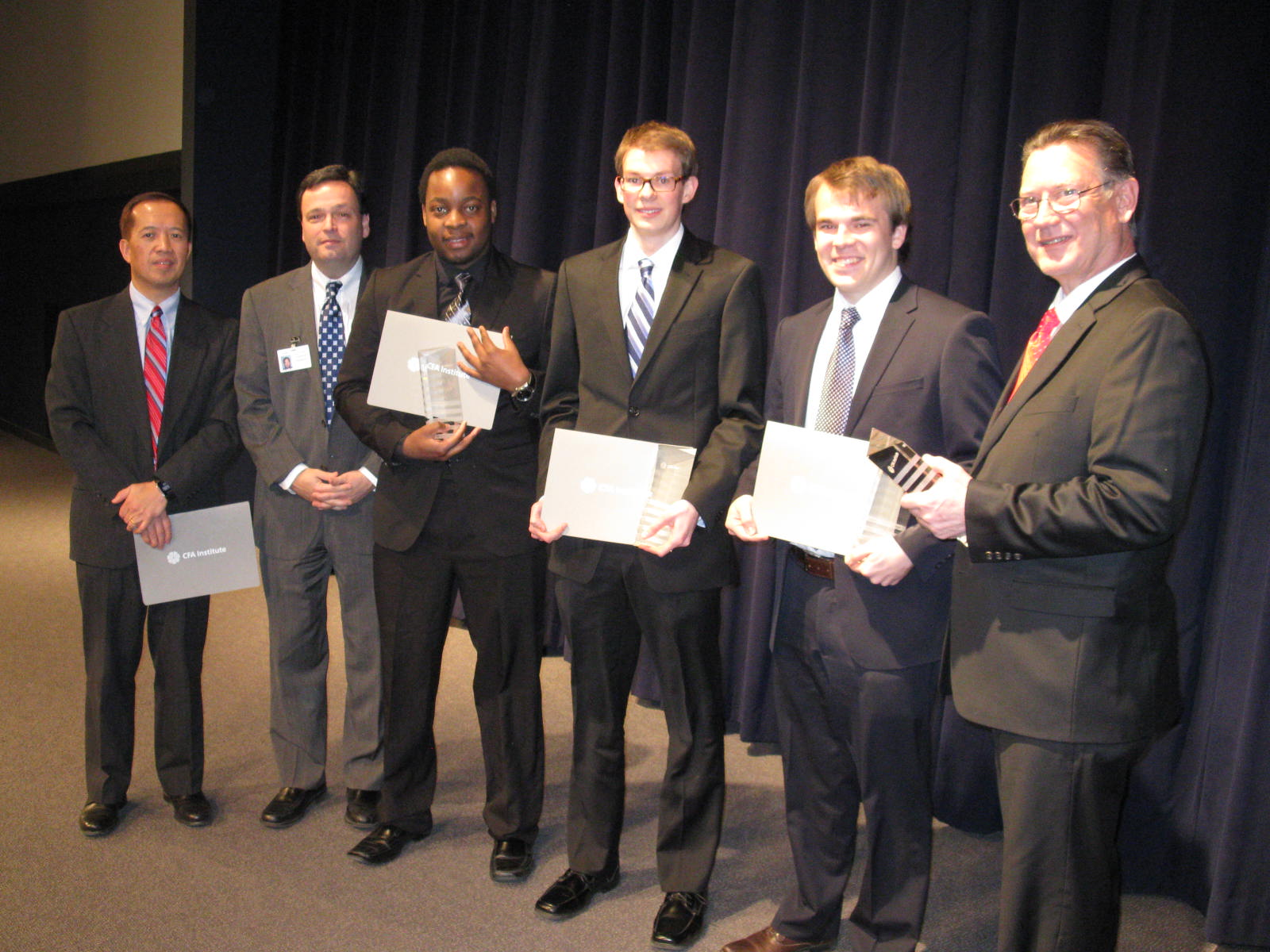 Analysts David Shoko, Lasse Fuss, & Sam Lohmeyer pose with Faculty Advisor Chuck Boughton